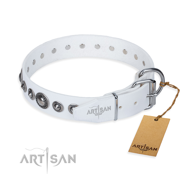 Natural genuine leather dog collar made of gentle to touch material with durable adornments